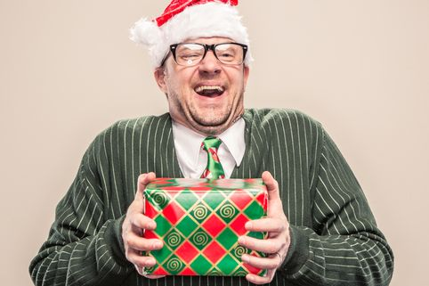 PROD-Nerdy-Geek-Christmas-Man-holding-wrapped-holiday-gift